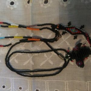 Bundle of two beaded necklaces 1 fly 1 lizard